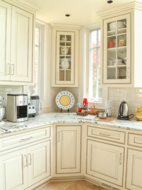 Cream Painted and Glazed Kitchen Cabinets