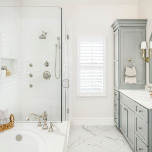 Inspiration for a transitional master white tile and porcelain tile porcelain tile, white floor and double-sink corner shower remodel in Charlotte with shaker cabinets, gray cabinets, an undermount tub, an undermount sink, quartz countertops, a hinged shower door, white countertops, a niche and a built-in vanity