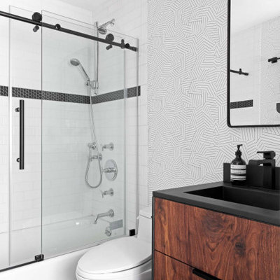 Small trendy 3/4 white tile and subway tile ceramic tile, black floor, single-sink and wallpaper bathroom photo in New York with flat-panel cabinets, medium tone wood cabinets, a one-piece toilet, white walls, an integrated sink, concrete countertops, black countertops and a freestanding vanity