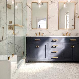 На фото: главная ванная комната среднего размера в стиле модернизм с фасадами в стиле шейкер, синими фасадами, угловым душем, разноцветной плиткой, керамогранитной плиткой, мраморным полом, мраморной столешницей, серым полом, душем с распашными дверями, белой столешницей, сиденьем для душа, тумбой под две раковины и напольной тумбой с