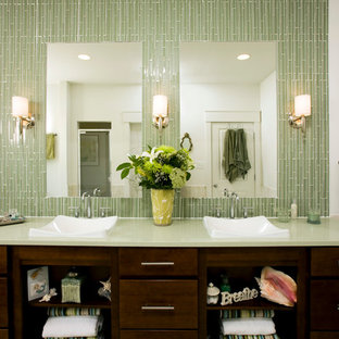 Inspiration for a traditional bathroom in DC Metro with a vessel sink, dark wood cabinets, green tiles, matchstick tiles, flat-panel cabinets and green worktops.