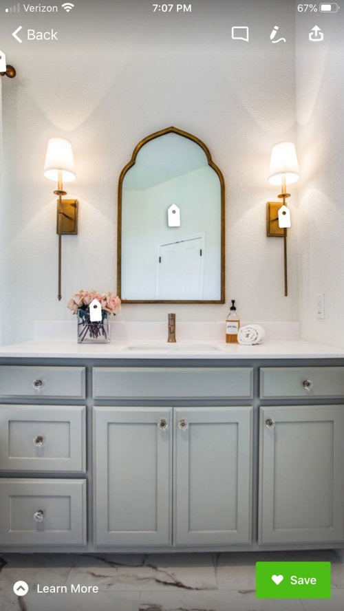 pulls, mirror, and lighting to match delta Champagne Bronze bathroom