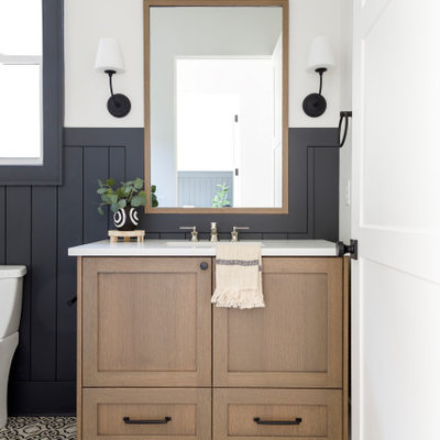 Small country kids' porcelain tile cement tile floor, single-sink and shiplap wall bathroom photo in Boise with flat-panel cabinets, medium tone wood cabinets, white walls, an undermount sink, quartz countertops, white countertops and a freestanding vanity
