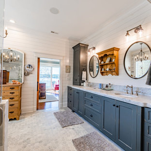 Large farmhouse master gray tile and marble tile marble floor, double-sink, shiplap wall, gray floor and coffered ceiling bathroom photo in Charlotte with recessed-panel cabinets, gray cabinets, an undermount sink, quartzite countertops, a hinged shower door, gray countertops, a built-in vanity, a one-piece toilet and gray walls