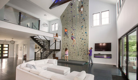 This Family Put a 26-Foot Rock Climbing Wall in Their Living Room