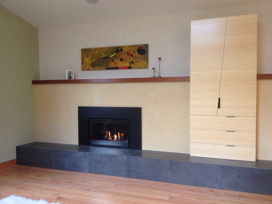 Gas fireplace with plaster surround and Sapele mantel (painting by Miro)