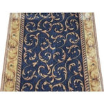 """Dean Flooring Company - Dean Navy Scrollwork Carpet Rug Hallway Stair Runner - Purchase by the Foot - Dean Navy Scrollwork Carpet Rug Hallway Stair Runner - Purchase by the Linear Foot : This runner is sold here by the linear foot. One unit of quantity when you checkout equals one foot of length on your runner. To order more than one runner, you must place separate orders. Width - Approximately 26"""". These beautiful carpet runners match our Dean Flooring Company stair treads. This item will be finished (serged with color matching yarn) on all four sides regardless of the length. It is made from polypropylene and acrylic with a woven backing. This runner is great for hallways, staircases, or as an accent rug."""