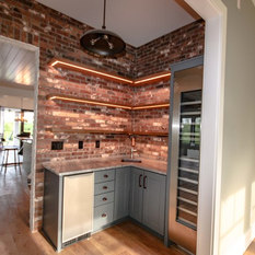 The Wine Room Has LED Lit Bar Shelvings That Really Draws Out Natural Look Of Bricks It Gives Character To Corner Space