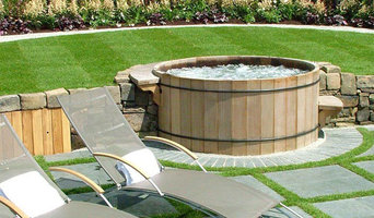 Backyard wood hot tub setting