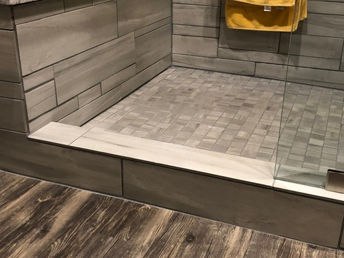 Walk In Shower With Curb Allowing Water To Run On Floor