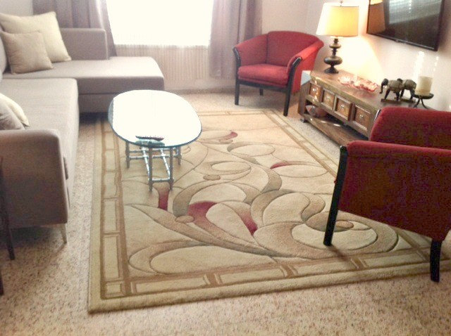 rich carpet with hints of burgundy to pick up on the chairs