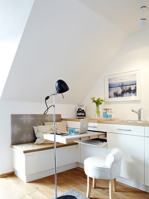 Small Trendy Light Wood Floor Living Room Photo In Munich With White Walls