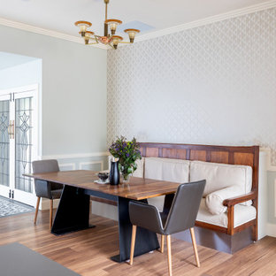 Inspiration for a contemporary dining room in Adelaide with grey walls, medium hardwood floors, brown floor, decorative wall panelling and wallpaper.