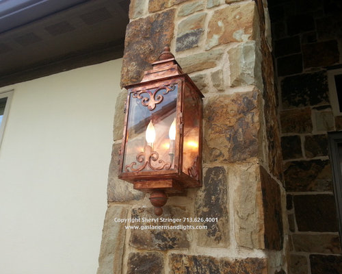 Sheryl's Electric Ornate Lantern with Two Bulb Candelabra Base, Natural Finish - Outdoor Wall Lights And Sconces
