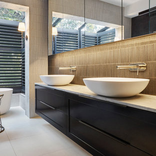 Photo of a large contemporary master bathroom in Melbourne with shaker cabinets, blue cabinets, a freestanding tub, a double shower, blue tile, ceramic tile, multi-coloured walls, ceramic floors, a vessel sink, marble benchtops, white floor, a hinged shower door, multi-coloured benchtops, a double vanity and a floating vanity.