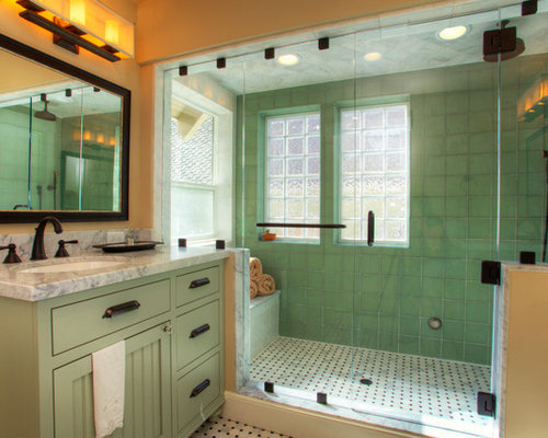example of an arts and crafts green tile multicolored floor alcove shower design in sacramento with