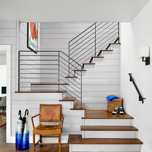 Staircase - country wooden u-shaped staircase idea in Austin with painted risers