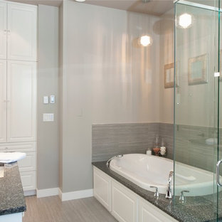 Example of a large trendy master gray tile and porcelain tile porcelain floor bathroom design in Vancouver with an undermount sink, raised-panel cabinets, white cabinets, engineered quartz countertops, a two-piece toilet and gray walls