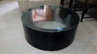 Round coffee table inside carved top glass
