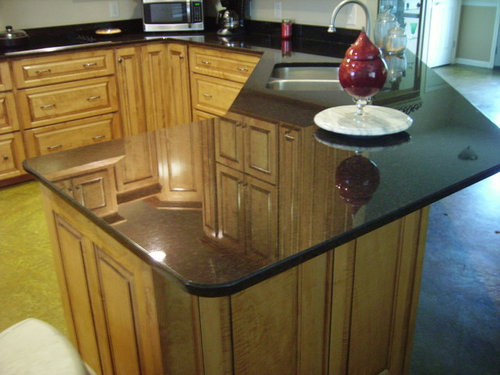 I HATE my black & silver speck granite counter tops, but $$$$