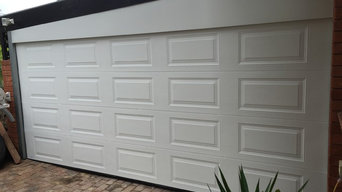Encosed Carport with a garage door