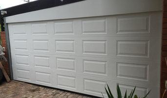 Encosed Carport with a garage door
