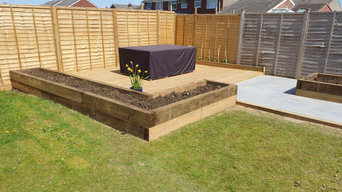 Tile patio, decking and raised sleeper beds.