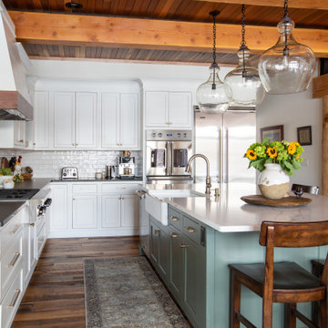 Open Concept Farmhouse Kitchen with Exposed Beams