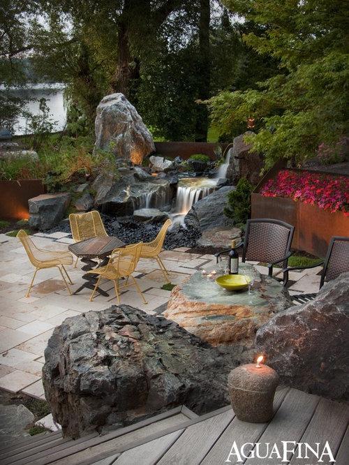 modelo de jardn de estilo zen de tamao medio en patio trasero con