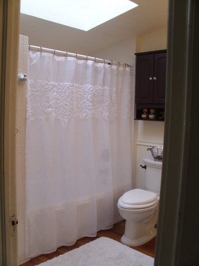 To the left of the shower curtain, she had a ceramic robe/towel hook ...