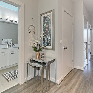 Mid-sized eclectic light wood floor and gray floor entryway photo in Philadelphia with white walls and a white front door
