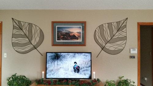 Large metal artwork above tv