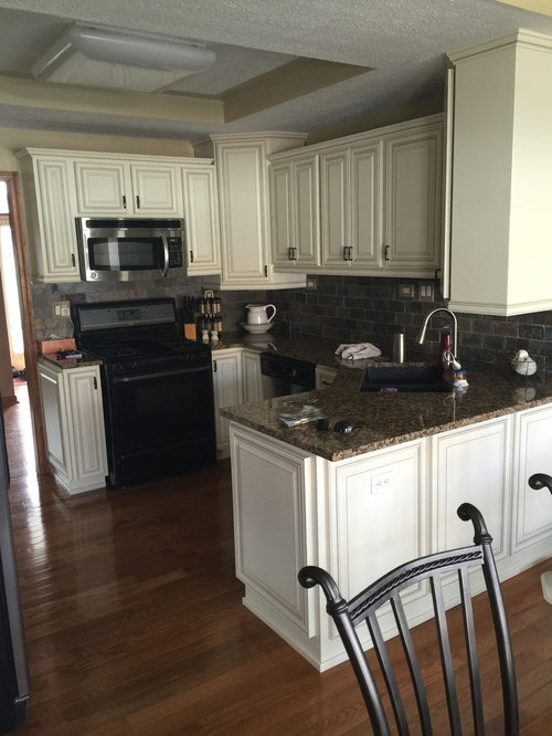 cabinet refacing--antique white brown glaze and granite