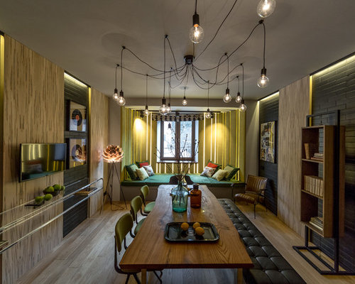Example Of An Urban Light Wood Floor And Beige Enclosed Dining Room Design In Moscow