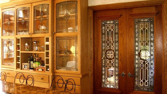 Etched and beveled leaded glass doors.