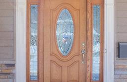 Wood Grain Front Door with Oval Window & Decorative White Trim