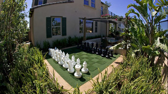 Giant Plastic Chess Set on Synthetic Chessboard