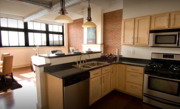 Gray Cabinets and Fireplace Feature Update a Loft