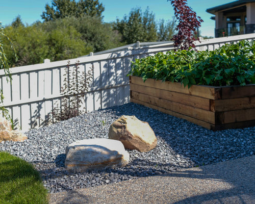 design ideas for a large contemporary shade backyard landscaping in edmonton with a vegetable garden and