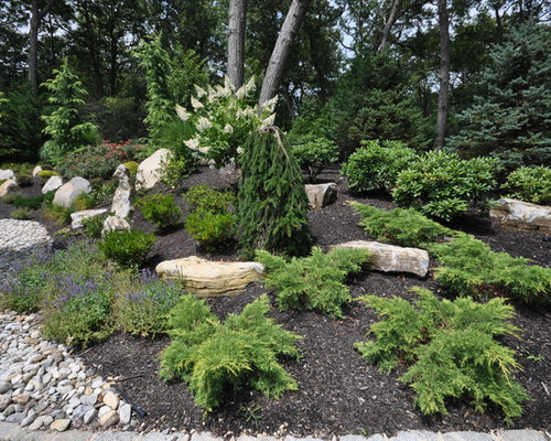 evergreen trees boulders gravel pathway in commack ny 11725