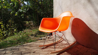 Orange Eames RAR rocking chair replica