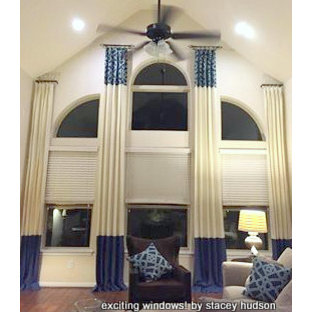 Drapery to Accent Large Arched Window with an Angled Ceiling