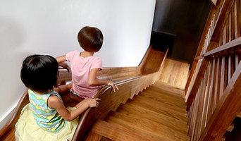 Custom walnut stairs and slide hybrid