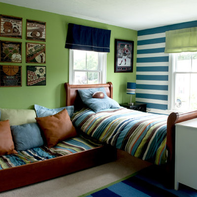 Example of a classic boy carpeted kids' room design in Boston with green walls