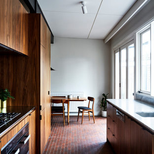 This is an example of a midcentury kitchen in Melbourne with marble benchtops, brick floors, red floor and yellow benchtop.