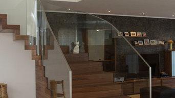 Faltwerktreppe mit Glasgeländer