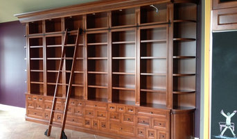 Large custom bookcase with rolling ladder
