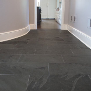 Example of a large classic slate floor hallway design in Chicago with gray walls