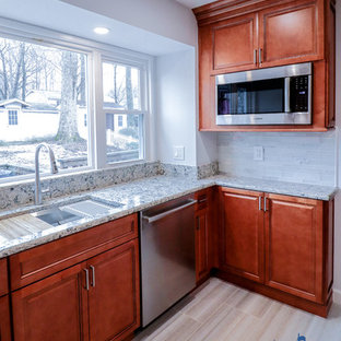 Design ideas for a mid-sized traditional u-shaped eat-in kitchen in DC Metro with an undermount sink, raised-panel cabinets, brown cabinets, quartz benchtops, white splashback, glass tile splashback, stainless steel appliances, ceramic floors, a peninsula, beige floor and multi-coloured benchtop.