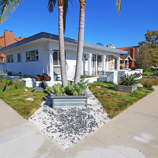 This is an example of a small modern drought-tolerant and partial sun front yard gravel landscaping in Los Angeles.